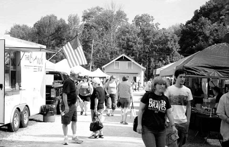 Black and white photo of vendor stands
